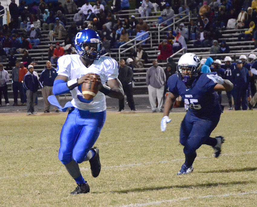 Antonio Williams looks downfield during a 2015 playoff game at Durham Hillside. Williams died in a car wreck in Durham Tuesday, June 16.