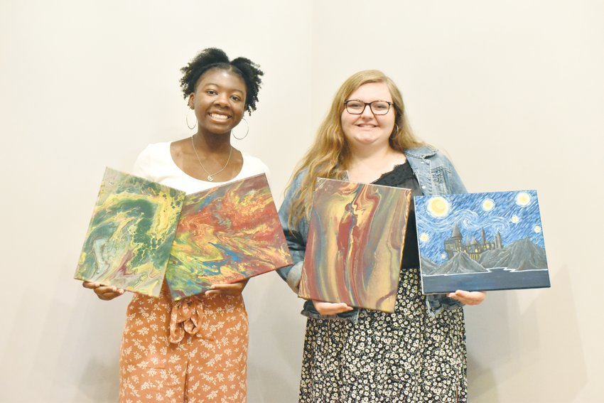 Longtime friends Tamia Lipscomb (left) and Eliza Fochler recently started their own business selling paintings. The Person High School graduates and current UNC-Charlotte students initally started their business Vibrant Vibes Art to raise money for college.