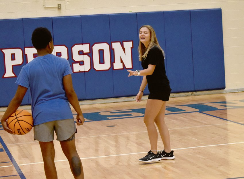 Evans and Holloway joke around during Thursday's workouts. Evans first discovered Rokcet basketball in classes taugh by head coach Jay Carmichael.