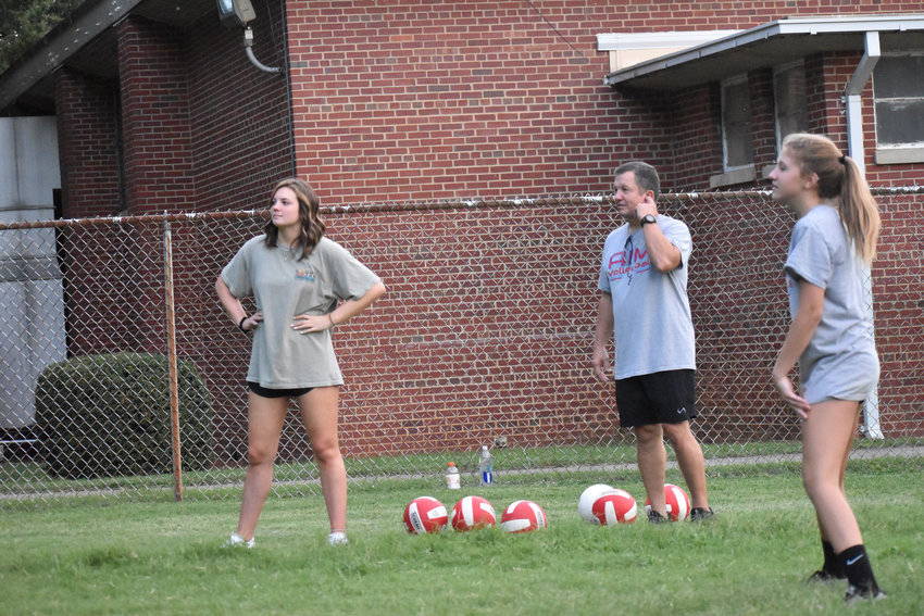 Brenaa (left) and Wesley Winstead watch campers in Teusday's clinics. The Winstead father-daughter duo is no stranger to volleyball – Wesley coached Brenna in her youth days, and Brenna now is a rising senior on the Roxboro Community School team.