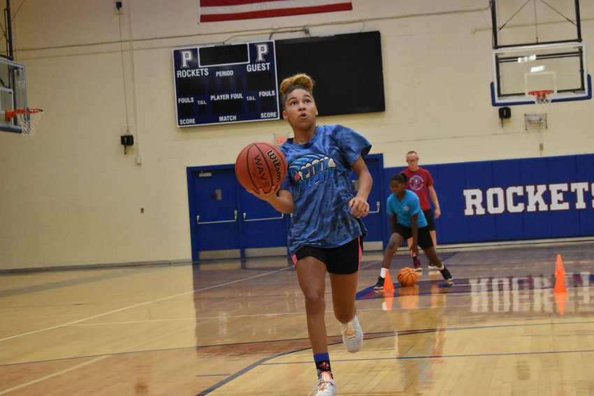 Ariyonna Smart lays the ball up in a drill at summer workouts on Thursday, Aug. 13. Smart, who comes from Northern Middle School, should make an immdiate impact in her first season at the high school level.