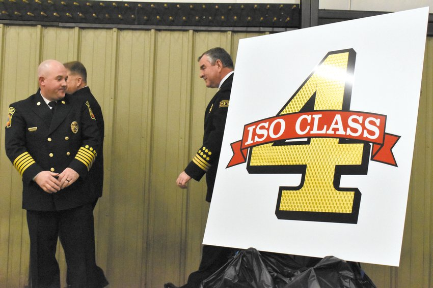 Timberlake Fire Chief Jason Fletcher, left, watches on as the department unveiled its new ISO rating of four in March. With the extra county funding from the five-point reduction, the Timberlake Fire and Rescue Department was able to establish a part-time paid position, a first for the county's volunteer departments.