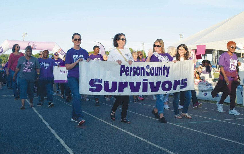 Susan Pierson Garrett, third from left, halps lead the 2019 survivor walk. Garrett was the Person County Relay For Life's survivor speaker.  The traditional Relay for Life for this year was canceled because of the COVID-19 pandemic, but will instead include a drive-thru survivors dinner at the Homestead Steakhouse on Sept. 18.