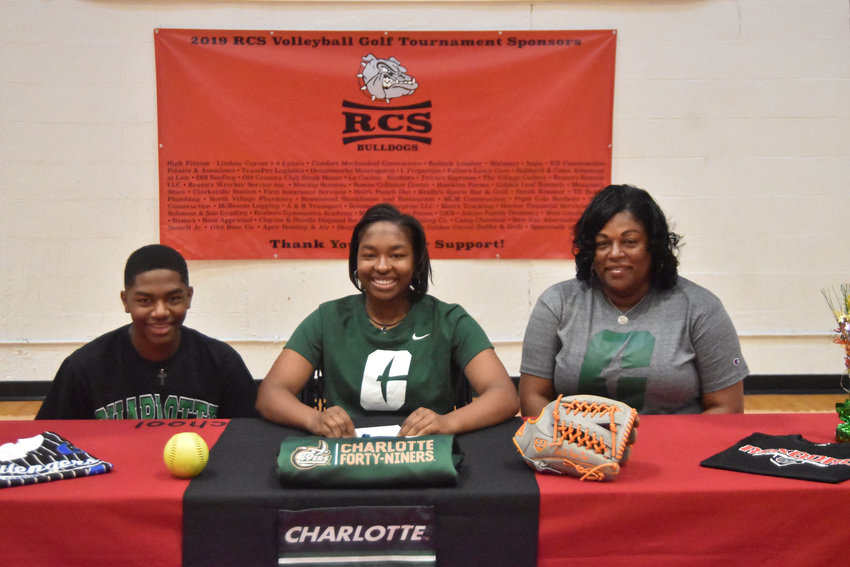 On Wednesday afternoon in the Roxboro Community School gymnasium, senior third baseman Zoe Russell signed with UNC-Charlotte to continue her softball career. Pictured here with Russell are mother Deana, right, and younger brother Ian.