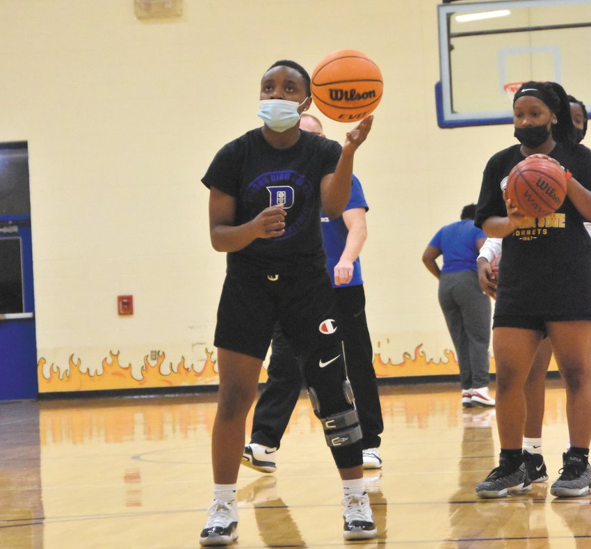 Senior guard Jewel Holloway shoots from the charity stripe in tryouts last month. Holloway will miss at least the first six games of the Rockets' season until she is cleared to play from a torn meniscus and partially torn ACL.
