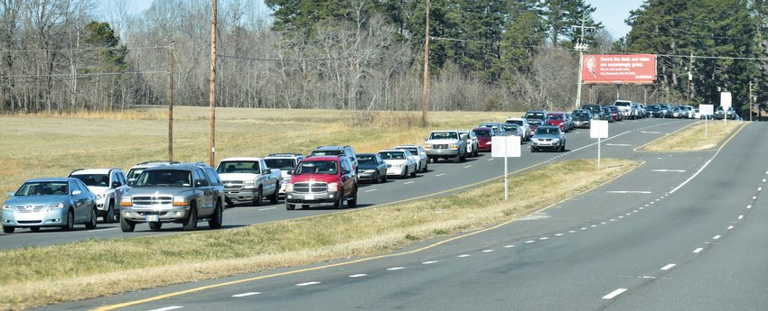 Motorists lined Durham Road Wednesday for the chance to get the first dose of their COVID-19 vaccine. The Person County Health Department held the first of two drive-thru clinics for health care workers and individuals aged 75 or older.