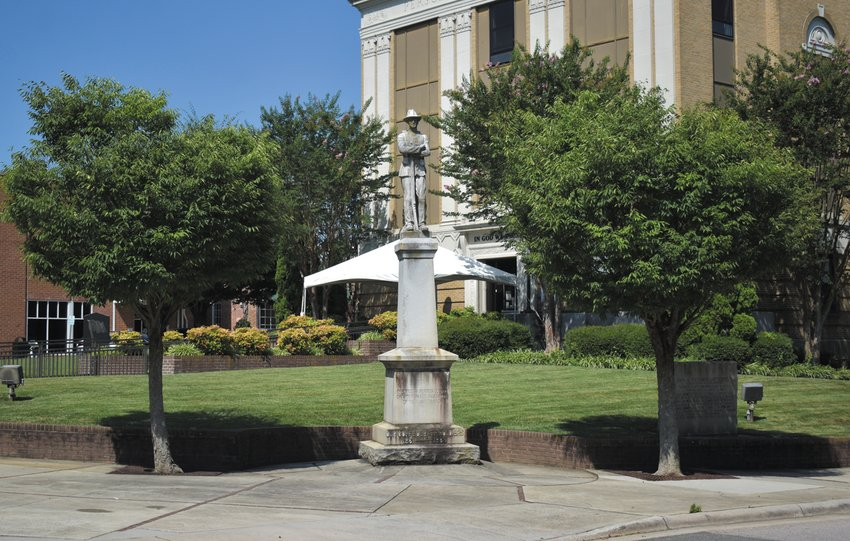 "The statue and monument honoring Person County's Confederate veterans will stay a little while longer as their removal and relocation to the Person County Veterans Park has been ""put on hold"" as the county's anonymous donor to move them for free has pulled out of the deal, according to Person County Board of Commissioners' chairman Gordon Powell."