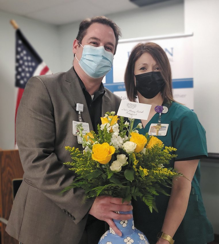 Person Memorial Hospital CEO David Ziolkowski presented PMH Director of Pharmacy Kasey O'Quinn flowers after she was named the hospital's Mercy Award winner.