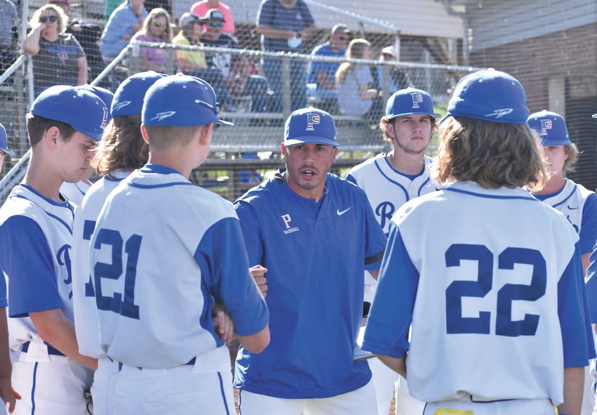 Person JV baseball head coach Jarren Winstead fires up his team between innings of Thursday's game against Northern Guilford.