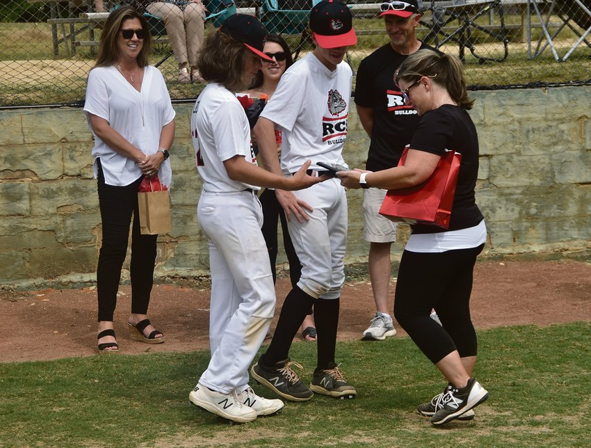 Roxboro Communtiy School eighth grader Anderson Long gives mom and head coach Leighann Long an award before Monday's game.