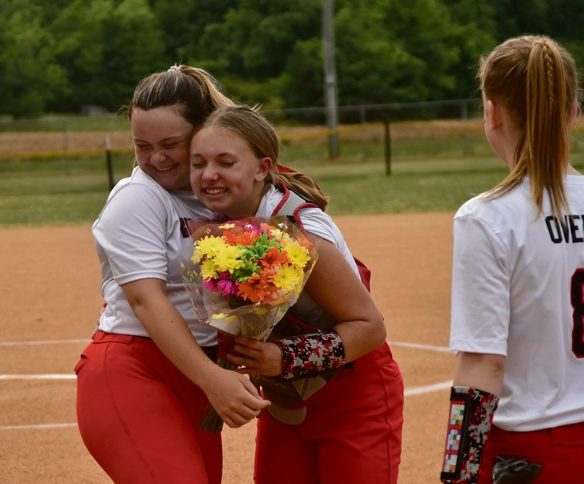 Carlie White's teammates presented her with flowers and gifts before the game.