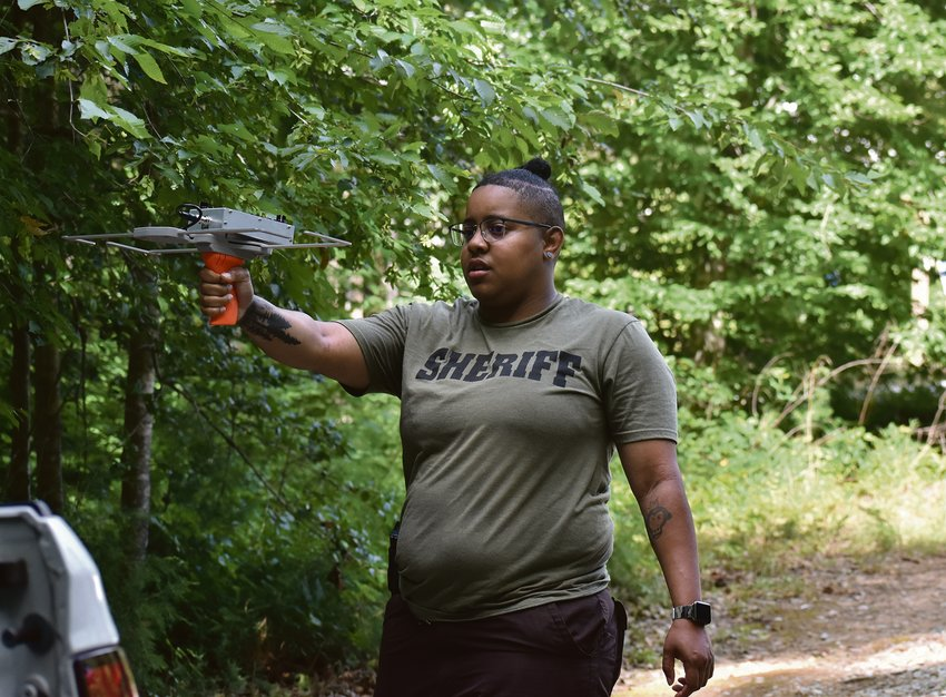 Person County Sheriff's deputy Akira Sampson trains with the Project Lifesaver technology Tuesday at Mayo Lake