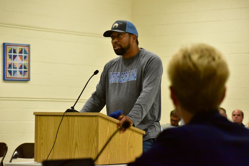 Department of Social Services Board Chairman Ray Jeffers addresses the Person County Board of Commissioners during the informal comment period in Monday's meeting. Jeffers spoke out against a proposed consolidation of the DSS and Health Department by Commissioner P.J. Gentry.