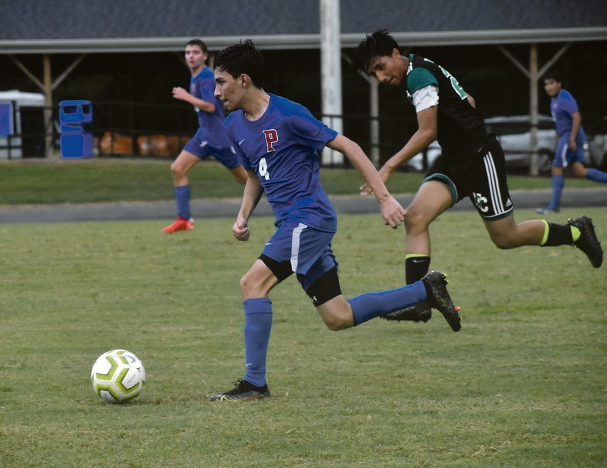 Perrson's Elias Alcaraz moves the ball up the field during Monday's game against Vance County..