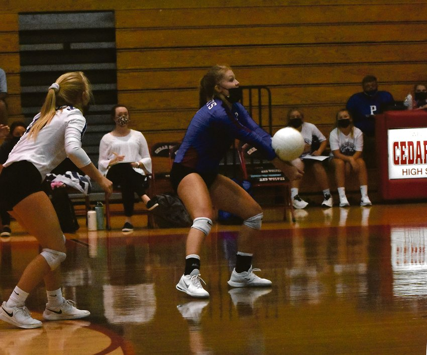 The play of the Person High School volleyball team's back row kept it in sets one and two against a powerful, Cedar Ridge squad.