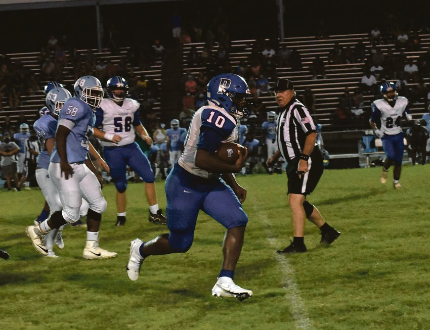 Jerry Oakley sprints toward the end zone on the Rockets' lone touchdown of the night. Halifax County (Va.) beat Person High School by a 42-8 margin.