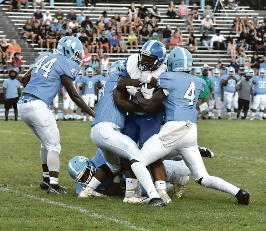 Daveon Marner is swarmed by Halifax County (Va.) defenders in last Friday's game. He and his Rocket teammates are looking for win number one tomorrow.