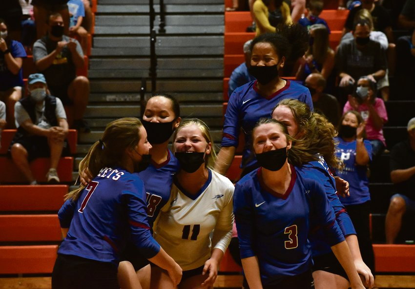 The Person High School JV volleyball team celebrates after knocking off Orange last Thursday on the road.