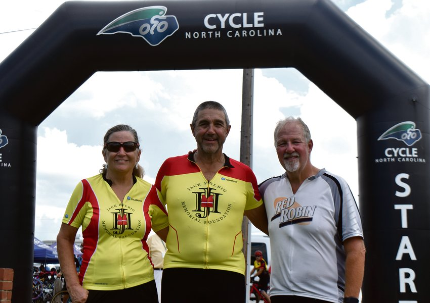 Gene Helbig (center) is joined by friends Laura Howell (left) and Joe Kugler on the Cycle NC Mountains-to-Coast ride. Helbig is cycling in memory of his grandson, Jack, who drowned 11 years ago. Jack's mother, Kelly, a Person County native, started the Jack Helbig Memorial Foundation in his honor.