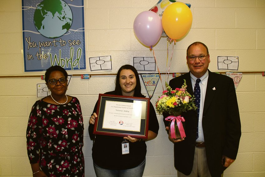 North Elementary third-grade teacher Tori Ashley was recently honored as the Person County Schools' Beginning Teacher of Excellence. Ashley was presented a framed certificate by (left) North Elementary School principal Nell Sydnor-Waugh and (right) Person County Schools superintendent Rodney Peterson.