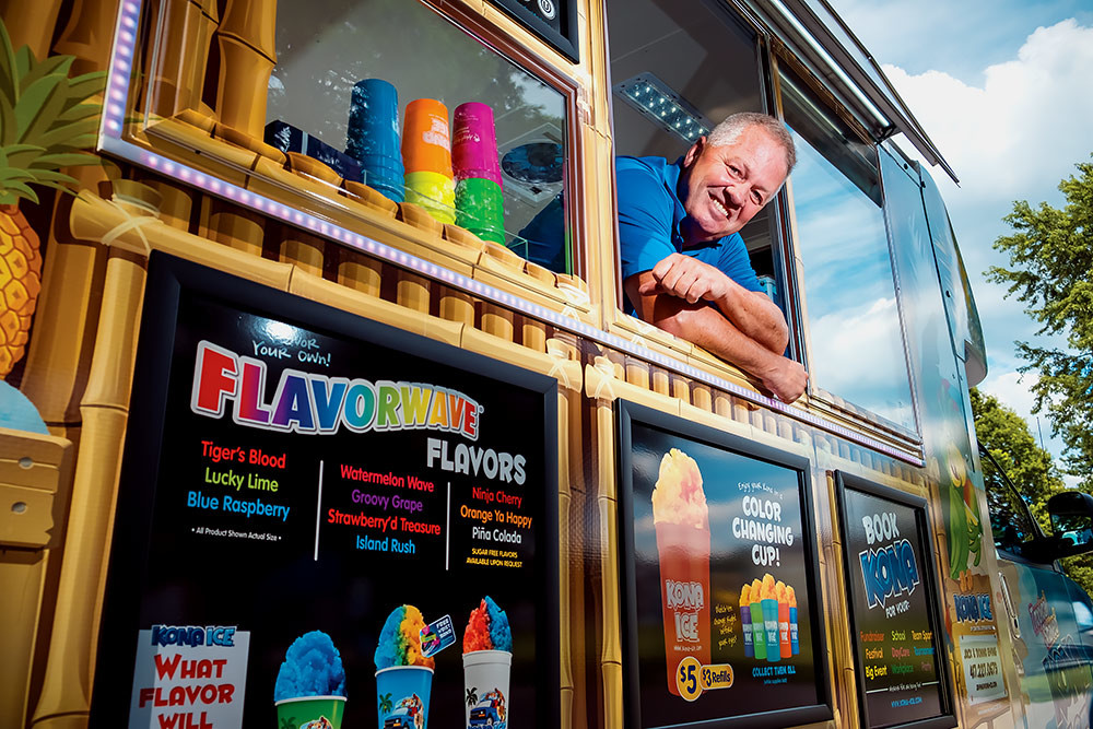 COOL DOWN: Franchisee co-owner Jack Ewing is surfing the Flavorwave after receiving his self-sufficient Kona Ice truck this summer.