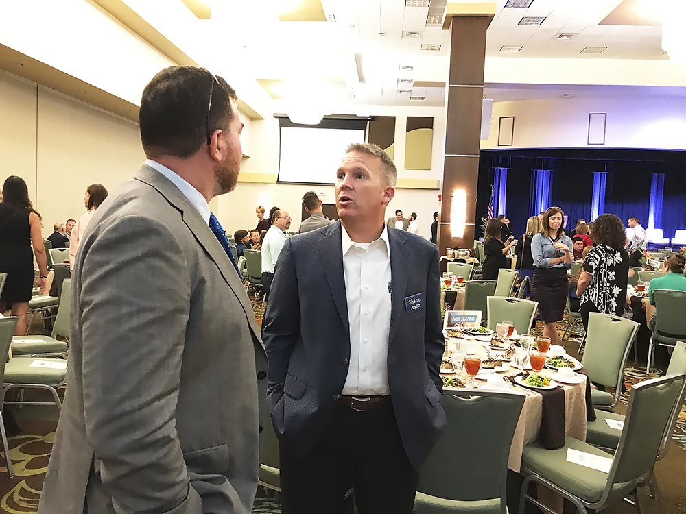 Roughly 450 people attended Springfield Area Chamber of Commerce's annual Membership Luncheon on Aug. 9 at Oasis Hotel & Convention Center. Above, Missouri State University's Jeff Schmedeke, left, and Arvest Bank's Shane Cowger talk before the luncheon.