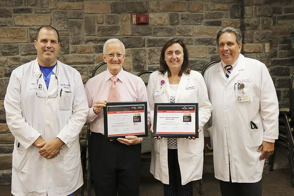 Heart HealthyThe American Heart Association honored Citizens Memorial Healthcare's dedication to cardiac care quality with two awards. The gold and bronze honors are given for demonstrating excellent patient outcomes for 12 consecutive months and implementing specific quality improvement measures for heart attack patients. Pictured are Dr. Joseph Moore, left, CEO Donald Babb, Jane Smith and Dr. John Best.
