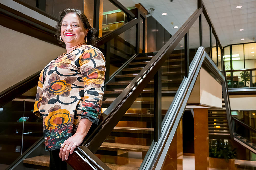 STANDING TALL: Kelsi Hall, president of Plaza Realty & Management Services LLC, says The Tower Club renovation is part of a larger update to the 30-year-old landmark.