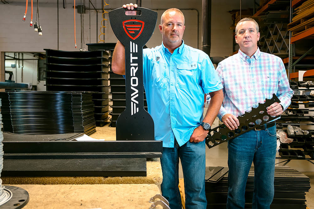 PARTNERS IN PRODUCTION: Brothers Mark, left, and Mike Miller run plastics manufacturer Polyfab, which their father started 45 years ago and now has clients globally.