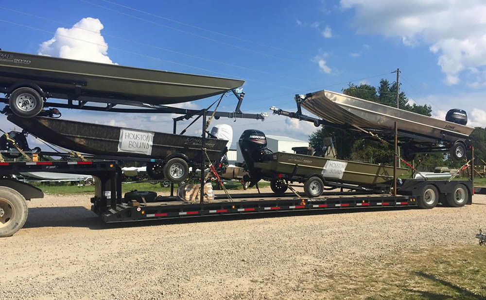 Lowe Boats prepares a shipment of Roughneck boats to be sent to the Houston area.