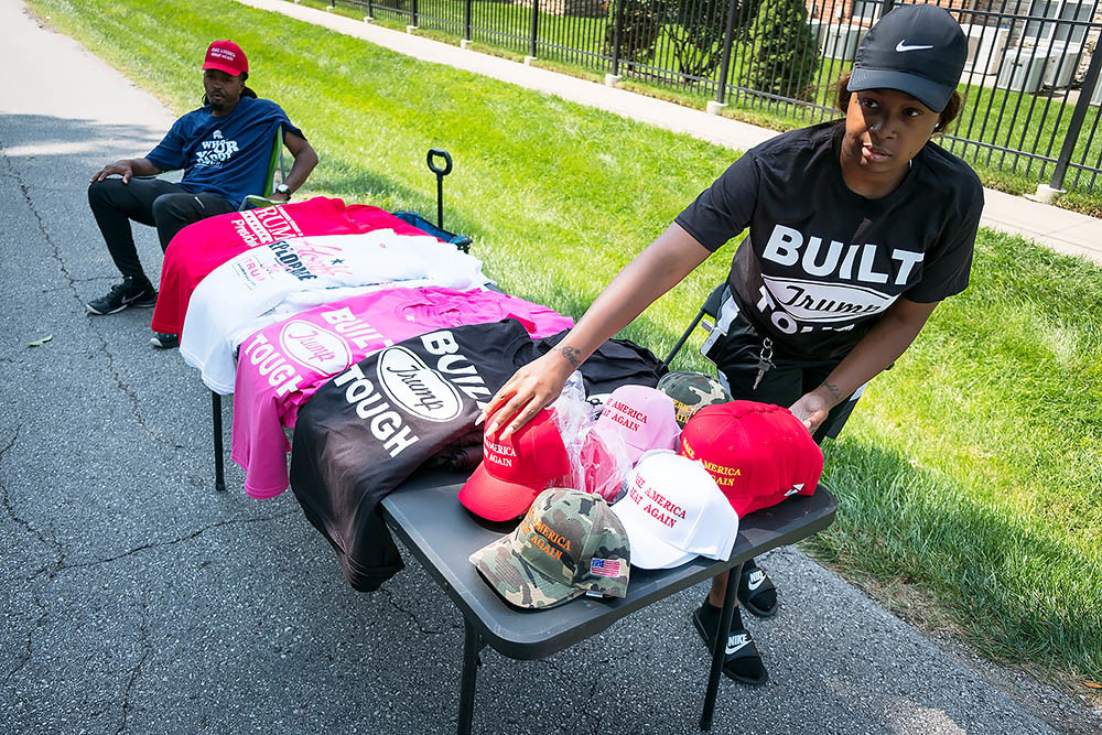 Vendors sells merchandise to attendees near Loren Cook Co.