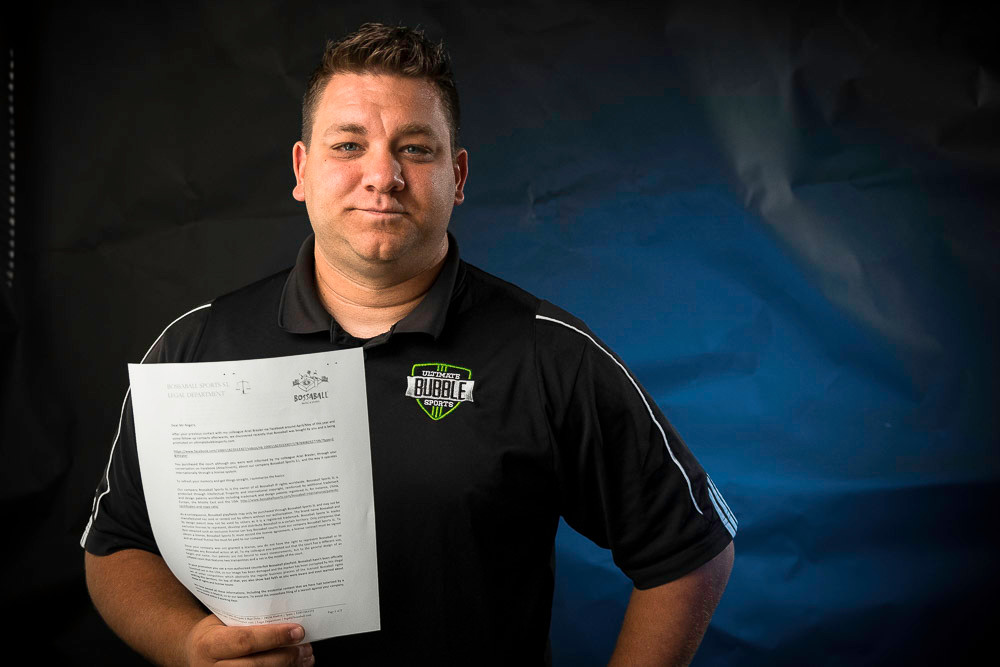Luke Rogers holds the cease-and-desist letter a Spanish company sent him.