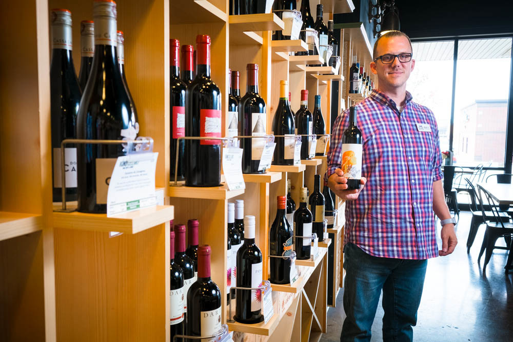 CHEERS: Matt Bekebrede holds a bottle of The Matriarch, Vino Cellars' first private-label wine.