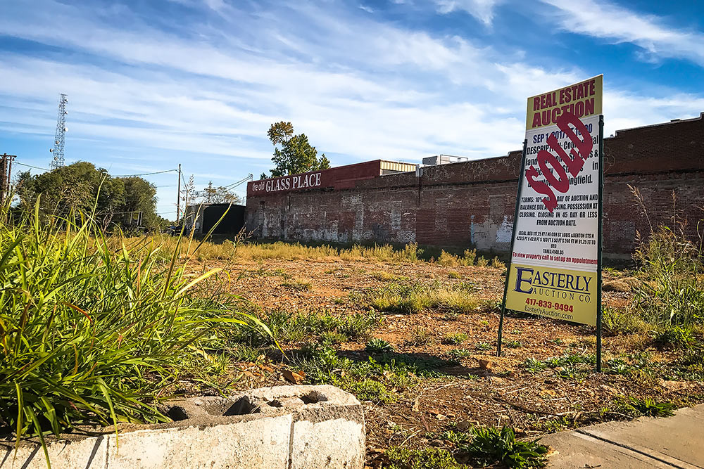 Tillman Redevelopment LLC buys downtown property next to The Old Glass Place.