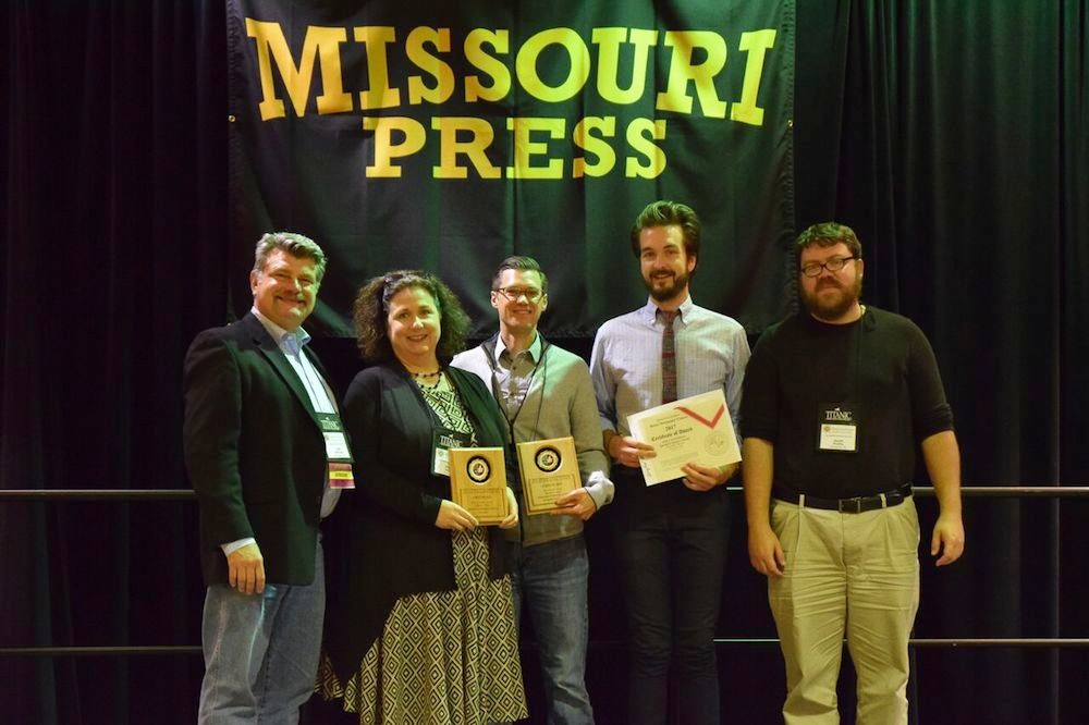 Missouri Press Association President Jeff Schrag, at left, presents four awards to Springfield Business Journal Publisher Jennifer Jackson, Editor Eric Olson, Editorial Designer and Photographer Wes Hamilton and Web Producer Geoff Pickle.