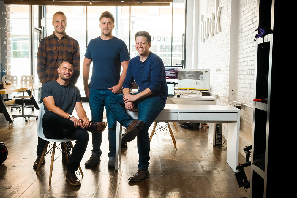 FRIENDS FIRST: Hook Creative's team describes themselves as a tight-knit group of friends. Pictured, from left, are Bryan Simpson, Nick Stewart, Mark Kelly and, seated, founder Josh Stewart.