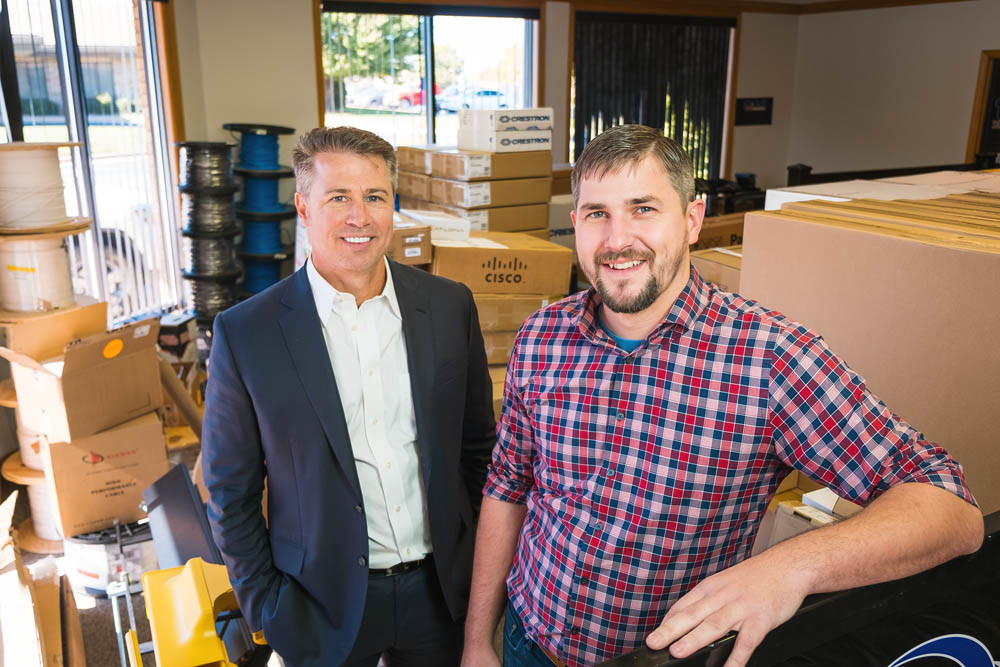 TECH ON THE MOVE: Doug Pitt, left, and Kevin Waterland of Pitt Technology Group are packing up to move from West Sunshine Street.