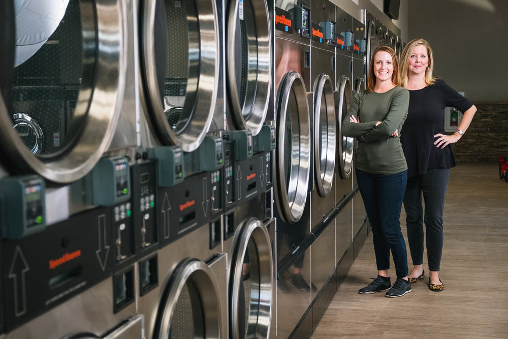SHINY AND NEW: Sister Kelly Luzecky, left, and Anne Harris run the day-to-day operations of the new high-tech laundromat.
