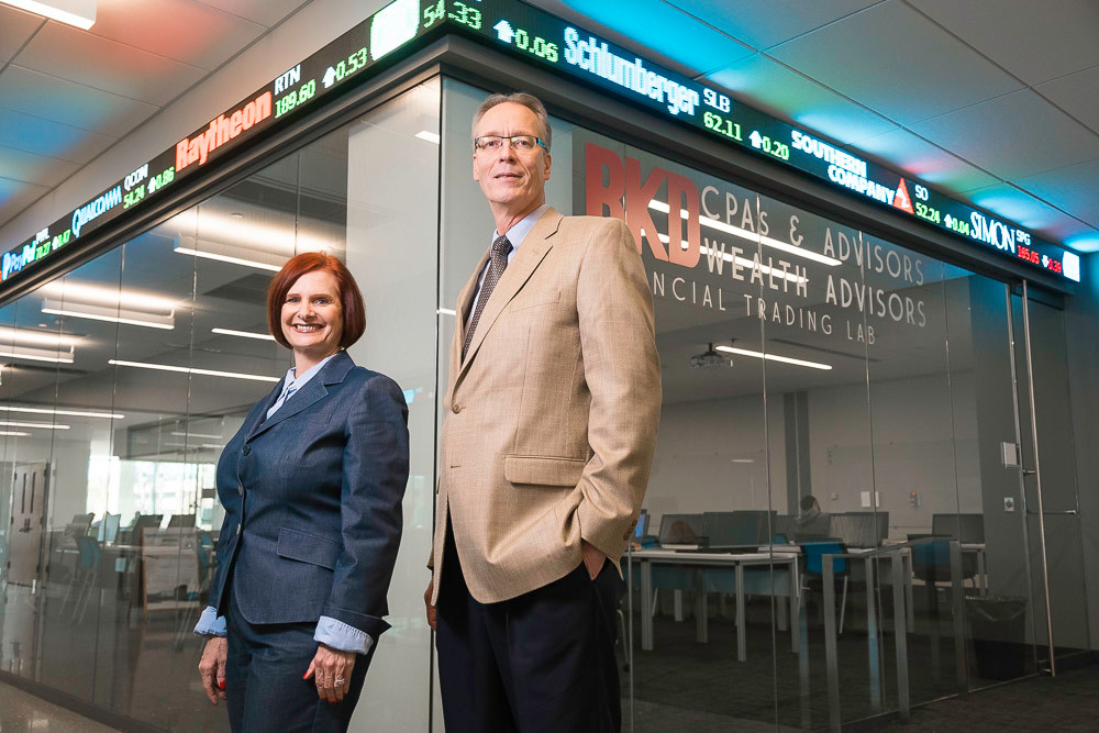 OPEN FOR BUSINESS: As David Meinert, right, takes over for Stephanie Bryant in MSU's College of Business, new programs are coming to students in Glass Hall.