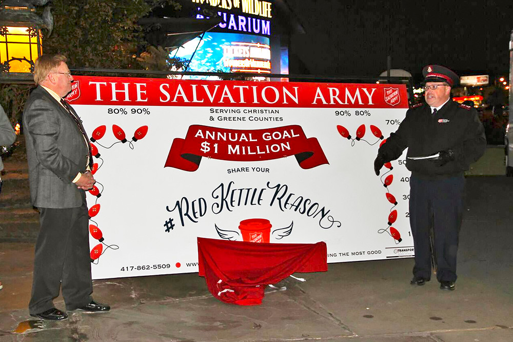 Mayor Ken McClure, Tree of Lights chairman, left, and Salvation Army Maj. Butch Frost unveil the nonprofit's annual goal.