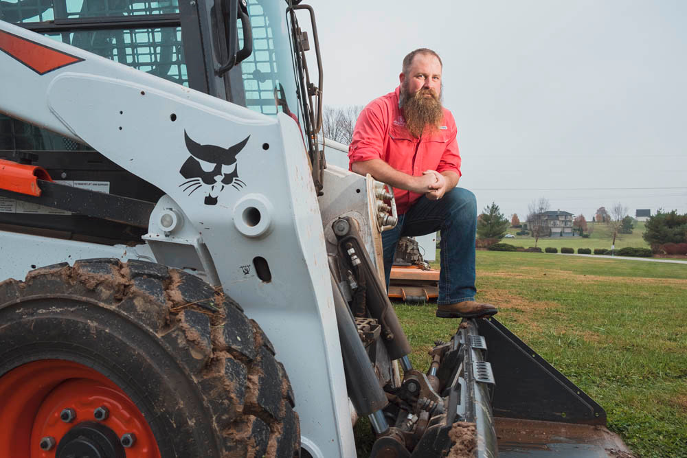 GOT YOUR BACK: Elite Outdoor Innovations owner Clint Harlan's Bobcat skid steer is part of the equipment he purchased with a Small Business Administration-backed loan.
