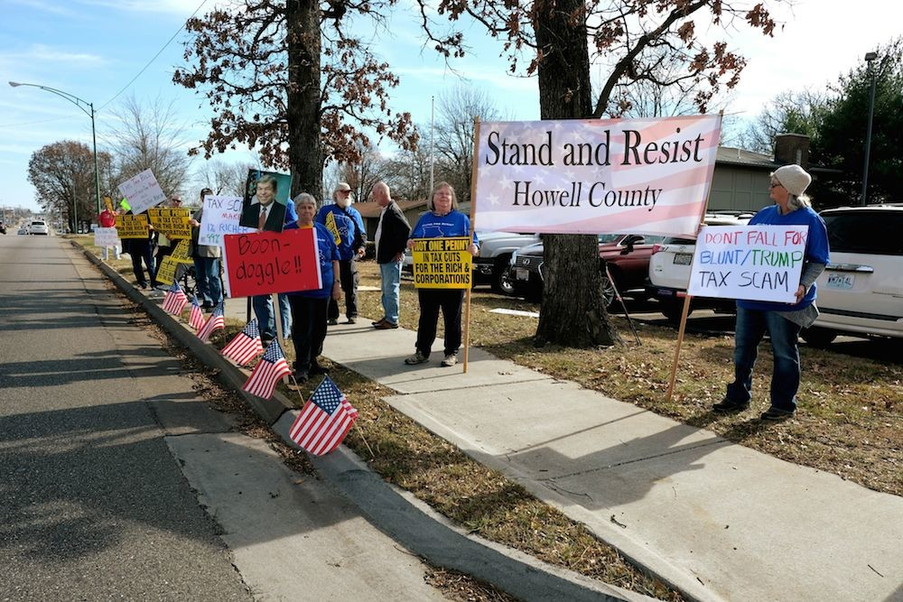 Tax reform opponents gather in front of Sen. Roy Blunt's Springfield office.