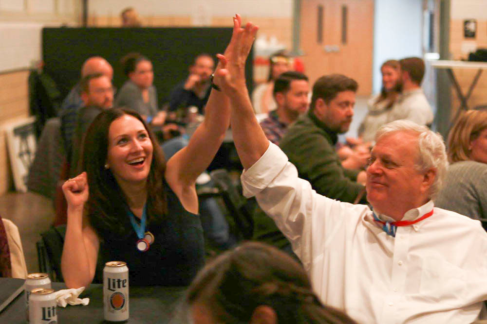 Megan Creson high-fives Craig Lowther to celebrate an answer on the way to Lowther Johnson Attorneys at Law taking first place at the Springfield Metropolitan Bar Association's trivia night Nov. 10 at The Fairbanks.