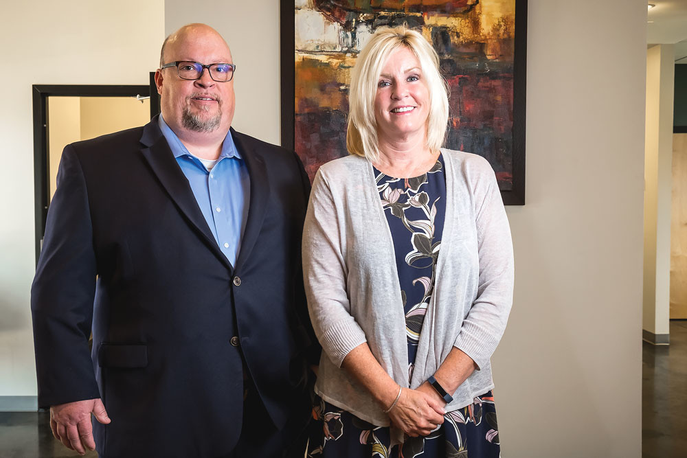Penmac, led by CEO Tim Massey and President Paula Adams, above, buys Minnesota's Employment Resource Center Inc.