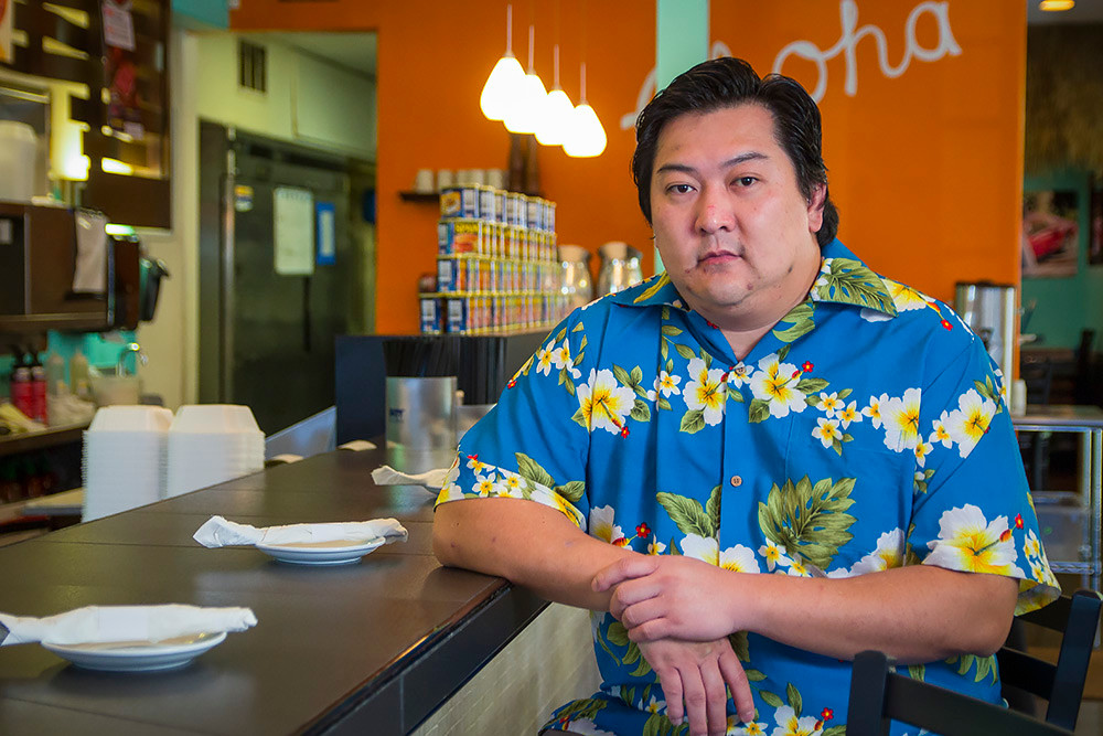 Johnson Tan, pictured, and his brother John Tan close The Big Island Grill.
