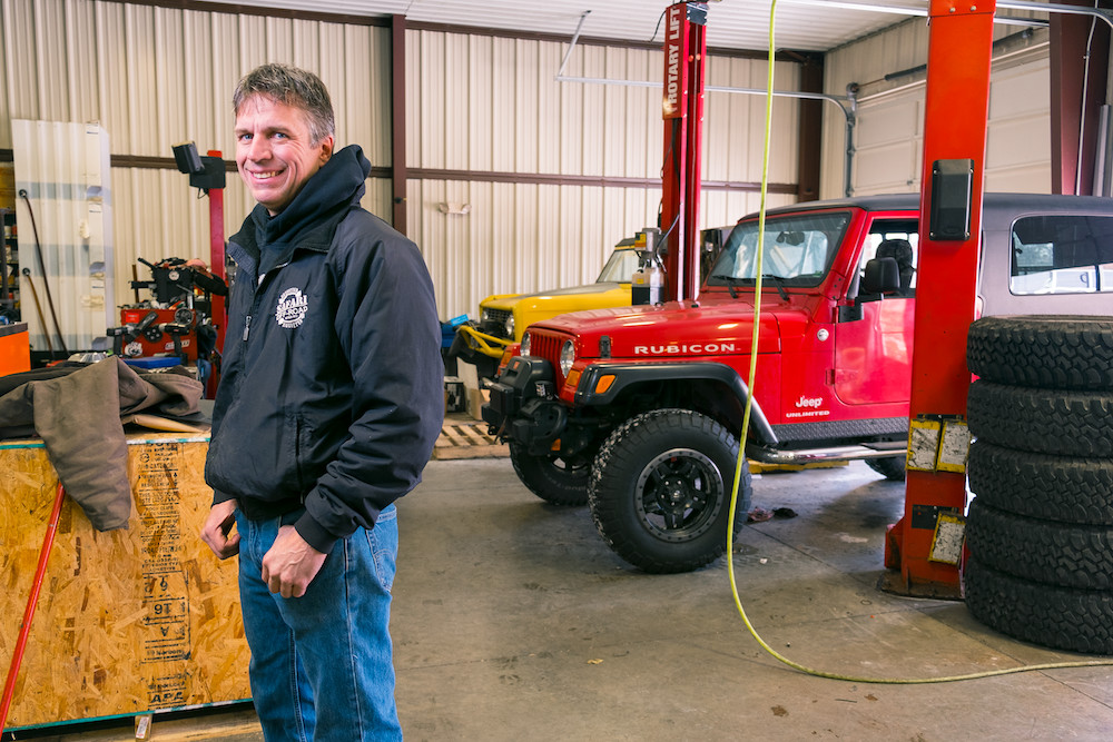 FROM THE ASHES: Shane Ballard stands in his eight-bay shop, for which he reinvested half-a-million dollars in 2010. The team now produces $1 million annually customizing off-road vehicles.