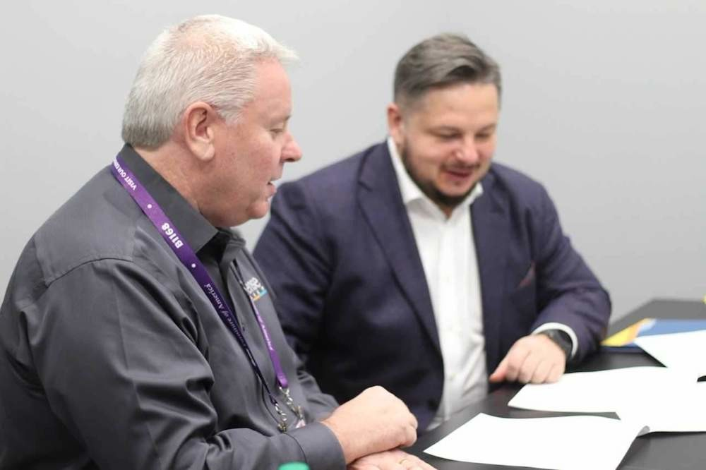 Advanced Sleep Technologies CEO Paul Longman, left, signs an iSense Sleep licensing contract with Askona CEO Roman Ershov.