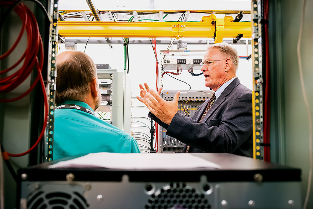 Mediacom's Area Operations Director Steve Bennett provides a tour of the Springfield facility and processing center, holding $5,000,000 of the newest broadband equipment.