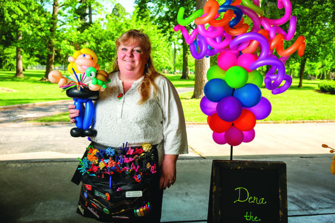 BALLOONING BUSINESS: Dena Atchley can twist balloons into cartoon characters and self-caricatures.SBJ photo by WES HAMILTON