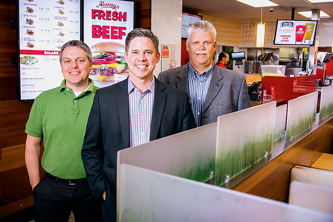 Hamra Enterprises executives Josh Sloan, left, Simeon Shelton and Randy Halterman are accountable as leaders in growth plans that include Wendy's.SBJ photo by WES HAMILTON